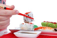 Free Holding One Roll With Chopsticks Royalty Free Stock Photos - 7039408