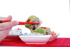 Free Holding One Roll With Chopsticks Royalty Free Stock Images - 7039409