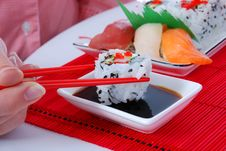 Free Holding Rolls One Roll With Chopsticks Royalty Free Stock Photos - 7039658