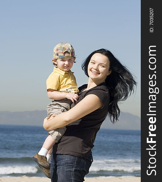 Young women holding little boy