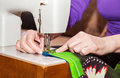 Free Woman&x27;s Hands Sewing On The Sewing Machine Stock Image - 70341191