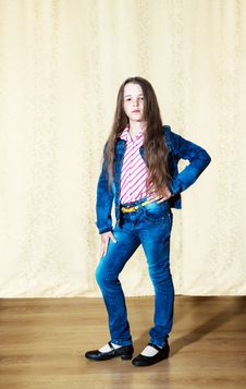 Free Little Girl With Long Hair In A Blue Denim Suit Stock Image - 70341011