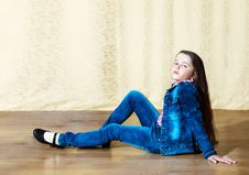 Free Girl In A Blue Denim Suit Sitting In The Studio Royalty Free Stock Photo - 70341065