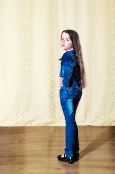 Free Little Girl With Long Hair In A Blue Denim Suit Stock Photo - 70341150