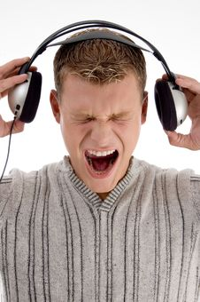 Free Shouting Young Man Holding The  Headphone Royalty Free Stock Images - 7042749