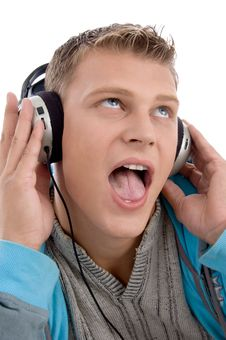 Free Man Listening Through Headphone Stock Image - 7042831