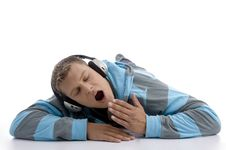 Free Yawning Man With Headphone Royalty Free Stock Image - 7042866