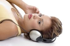Free Laying Woman With Headphone Looking At You Royalty Free Stock Photos - 7043278