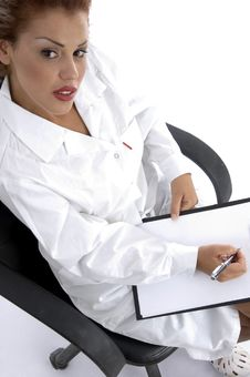 Free Sitting Doctor With Writing Board Stock Image - 7043441