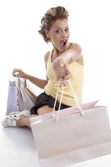 Free Sitting Sexy Woman Showing Shopping Bags Royalty Free Stock Image - 7043586