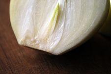 Onion On Cutting Board Royalty Free Stock Photo