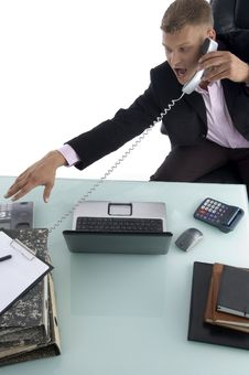 Free Sitting Businessman Busy On The Phone Royalty Free Stock Images - 7044249