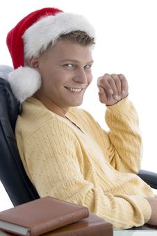 Free Handsome Male Wearing Santa Hat Looking At Camera Stock Photography - 7044702