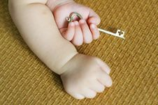 Free Baby Hold Gold Key Stock Photography - 7049552