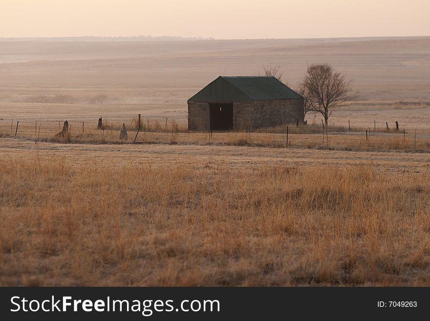 Stone barn at dawn