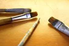 Free Paintbrushes On Wood Stock Image - 7050301