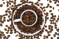 Background With White Mug Full Of Coffee Beans Stock Photo