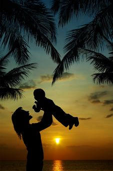 Silhouette Of Mother And Son At Sunset Stock Photography