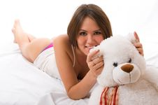 Free Beautiful Smiling Asian Girl With A Toy. Royalty Free Stock Images - 7051589
