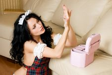Free Sexy Brunette Maid With Jewelry Royalty Free Stock Photography - 7053997