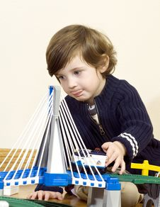 Little Boy Playing With Train Set Royalty Free Stock Photo