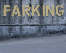 Yellow Parking Sign Painted On Cement Stock Images