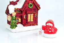 Free Funny Little Snowman With Small House In The Back Stock Photos - 7055383