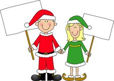 Boy And Girl Dressed For Christmas Holding Signs Royalty Free Stock Image