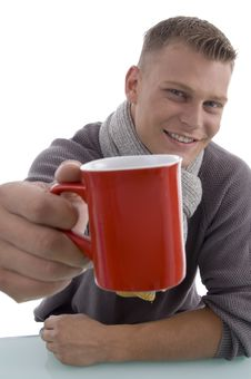 Free Handsome Young Man Showing Coffee Mug Stock Image - 7058131