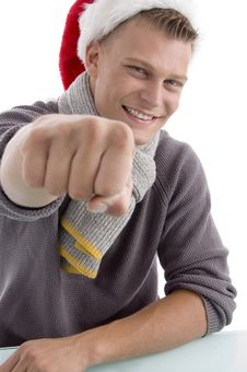 Free Smiling Young Man With Christmas Hat Showing Punch Stock Image - 7058481