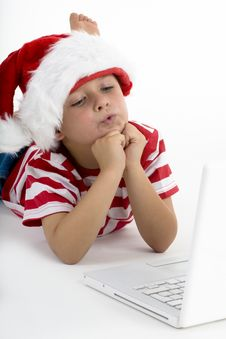 Free Santa S Elve With Laptop Stock Image - 7058511