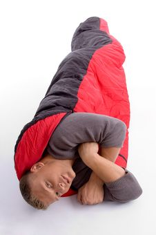 Free Young Man Covered Himself With Red Sleeping Bag Royalty Free Stock Photos - 7058568