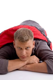 Free Young Man Covered Himself With Red Sleeping Bag Stock Image - 7058571