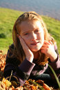 Free Autumn Girl In Grass Stock Photography - 7063102