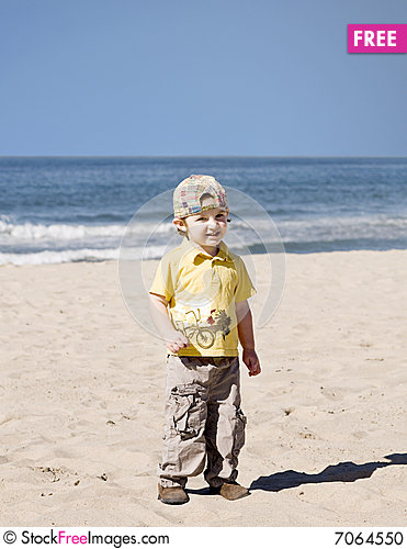 Free Little Boy Standing On The Beach Stock Photo - 7064550