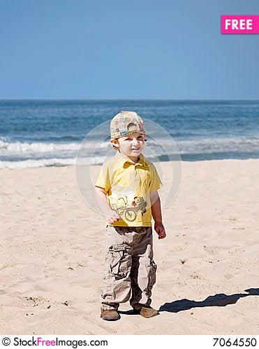 Free Little Boy Standing On The Beach Stock Photo - 7064550