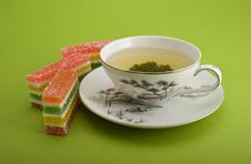Free Tea Cup And Jellies Royalty Free Stock Photography - 7060227