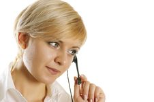 Free Girl Wearing Headset In Office Royalty Free Stock Image - 7060796