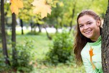 Free Smiling Girl And Falling Maple Leaves Royalty Free Stock Photography - 7062407