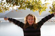 Free Happy Girl At The Autumn Lake Royalty Free Stock Image - 7063476