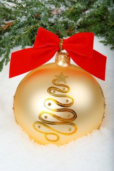 Christmas Bauble With Ribbon And Branch Stock Image