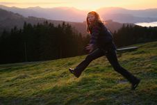 Free Jumping Girl In The Sunset Royalty Free Stock Photo - 7064805
