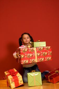 Girl With A Christmas Gifts Royalty Free Stock Photography