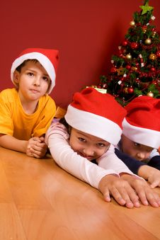Little Children As Santa In Red Cap Stock Images