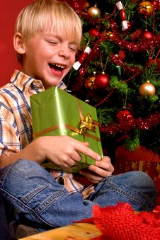 Free Laughing Boy With Christmas Gift Royalty Free Stock Photos - 7064988