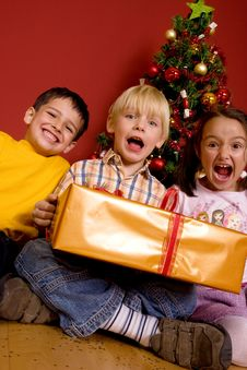 Laughing Children With Christmas Gift Stock Photography
