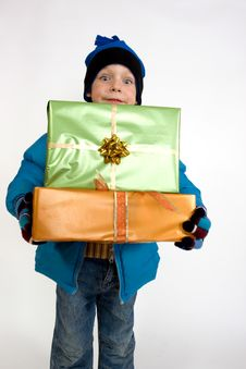 Free Little Boy With Christmas Gifts Royalty Free Stock Photo - 7065085