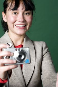 Free Portrait Of A Young Woman With Digital Camera Royalty Free Stock Photography - 7065107