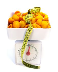 Apricots On The Scale Royalty Free Stock Photo