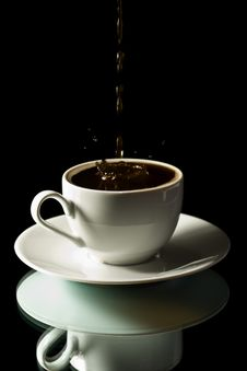 Coffee Splashing Into White Cup Stock Photo